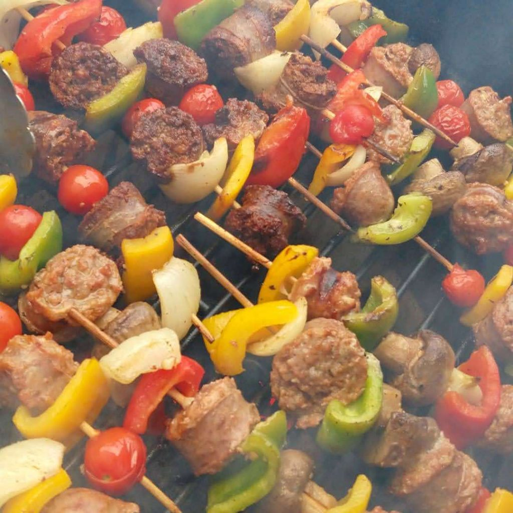 Italian sausage kebabs on grill